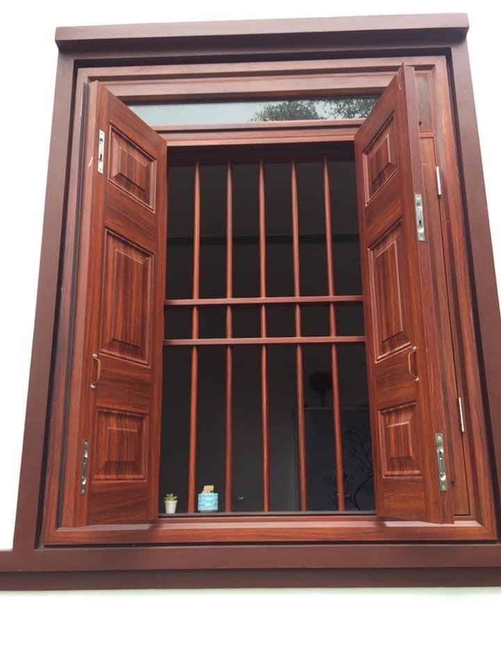 cửa thép vân gỗ giá rẻ tại TPHCM